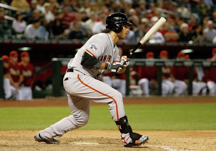 PHOENIX, AZ - APRIL 08:  Brandon Crawford #35 of the San Francisco Giants hits a RBI single against the Arizona Diamondbacks during the fifth inning of the MLB game at Chase Field on April 8, 2015 in Phoenix, Arizona.  (Photo by Christian Petersen/Getty Images) Photo: Christian Petersen / Getty Images / 2015 Getty Images