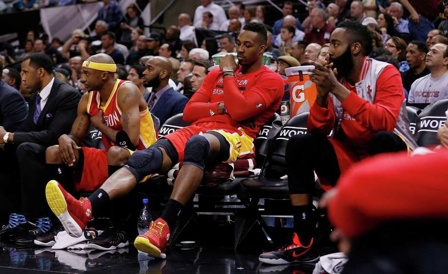 Houston Rockets' Jason Terry (31), Dwight Howard (12) and James Harden (13) sit out the final minutes of the game against the Spurs at the AT&T Center on Wednesday, Apr. 8, 2015. Spurs defeat the Rockets, 110-98. (Kin Man Hui/San Antonio Express-News) Photo: Kin Man Hui, Staff / San Antonio Express-News / ©2015 San Antonio Express-News