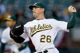 OAKLAND, CA - APRIL 08:  Scott Kazmir #26 of the Oakland Athletics pitches against the Texas Rangers in the top of the first inning at O.co Coliseum on April 8, 2015 in Oakland, California.  (Photo by Thearon W. Henderson/Getty Images)