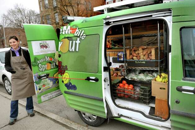 Veggie Sprout coordinator Liz Boyer has her produce truck on hand for a news conference during National Public Health Week on Wednesday, April 8, 2015, at Capital Roots in Troy, N.Y. (Cindy Schultz / Times Union) Photo: Cindy Schultz / 00031348A