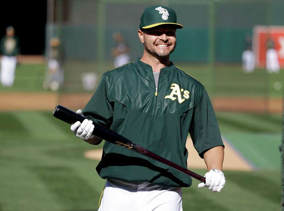 Oakland Athletics' Cody Ross takes batting practice before a baseball game against the Texas Rangers Wednesday, April 8, 2015, in Oakland, Calif. (AP Photo/Marcio Jose Sanchez) Photo: Marcio Jose Sanchez / Associated Press / AP