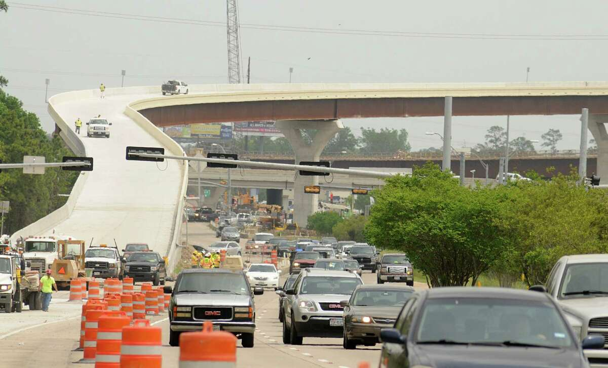 Traffic passes on the westbound lanes of Highway 242 at the exit of the 242 flyover from Interstate 45. The $34 million project is scheduled to open in two to three weeks. Photograph by David Hopper