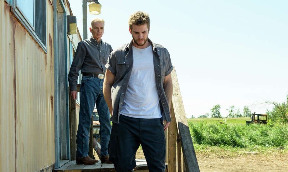 """Dwayne (Liam Hemsworth) earns meager wages while working for his girlfriend's dad, played by Billy Bob Thornton, in """"Cut Bank."""" Photo: A24 Films / A24 Films / Dan Power"""