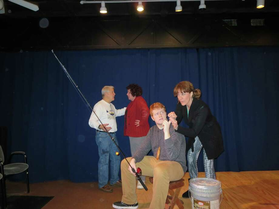 """Roger Bauer, left, directs Elizabeth Barry along with William Pocklington and Karen Lasater in """"A Company of Wayward Saints"""" in Rosenberg. Photo: Don Maines"""