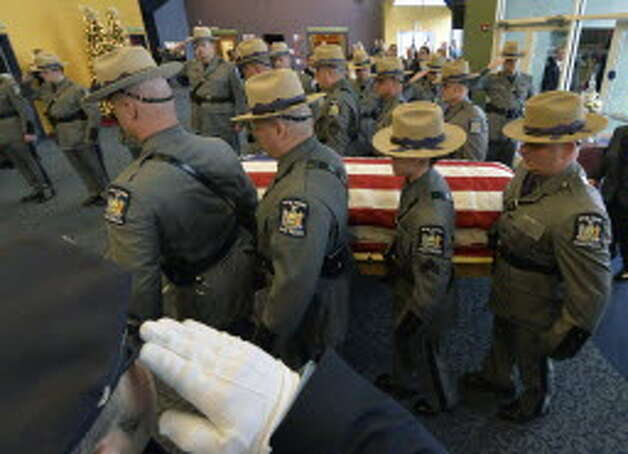 State Police carry the casket of Trooper David Cunniff on Friday, Dec. 20, 2013, at Grace Fellowship Church in Colonie, N.Y. (Skip Dickstein/Times Union)