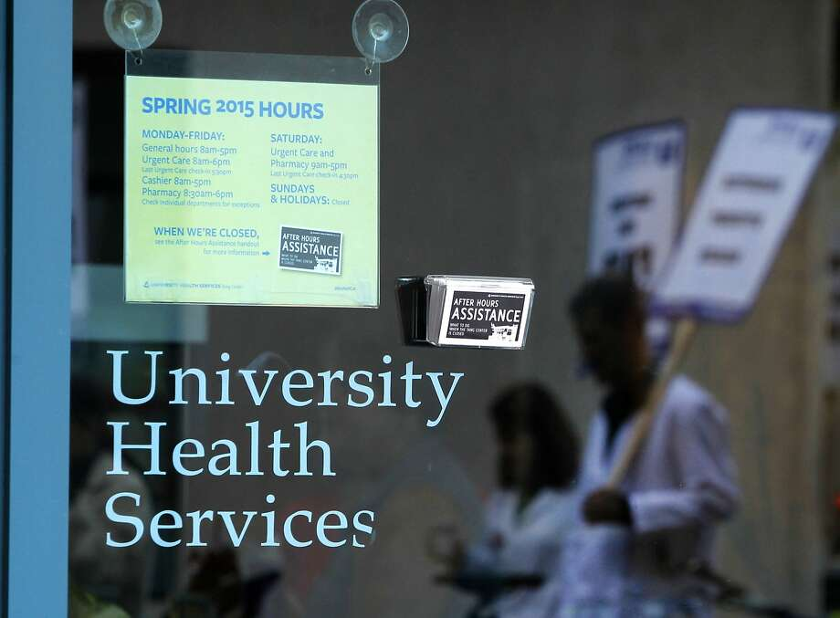 Doctors from the student health center at Cal walk a picket line in Berkeley, Calif. on Thursday, April 9, 2015. Doctors from student health clinics throughout the University of California system are beginning a four-day walkout to protest what they say are unfair labor practices by university officials. Photo: Paul Chinn, The Chronicle