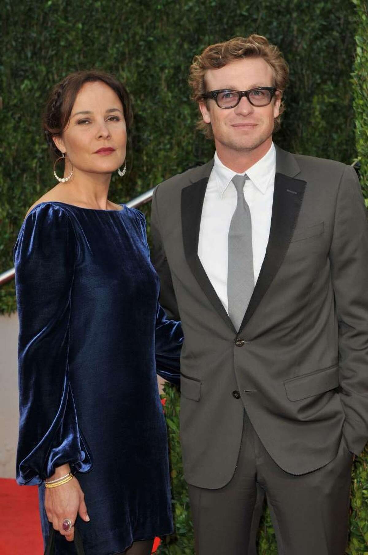 WEST HOLLYWOOD, CA - MARCH 07: Actor Simon Baker (R) and wife Rebecca Rigg arrive at the 2010 Vanity Fair Oscar Party hosted by Graydon Carter held at Sunset Tower on March 7, 2010 in West Hollywood, California. (Photo by Pascal Le Segretain/Getty Images) *** Local Caption *** Simon Baker;Rebecca Rigg