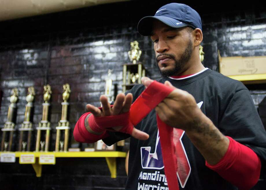 Boxer James Kirkland wraps his hands prior to practicing during a media event, on April 8, 2015, at San Fernando Boxing Club in San Antonio. Photo: Darren Abate /For The Express-News / San Antonio Express-News