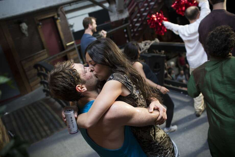 Paul McCloud kisses Ashley Ortega during Daybreaker, a device-free dance party hosted by Digital Detox and Camp Grounded, at Inner Mission in San Francisco, Calif. on Thursday, April 9, 2015. Photo: Tim Hussin, Special To The Chronicle
