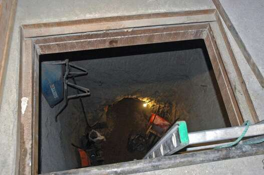 The entrance to a drug dealing tunnel is discovered in a home in Tecate, northwest of Mexico in 2007.  A police commander of the bordering Tecate municipality, Juan Jose Soriano Perez, was murdered Tuesday a few hours after the find of a drug dealing tunnel that goes from Mexican territory into the United States. Photo: AFP, AFP/Getty Images