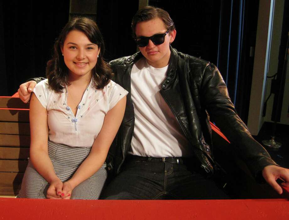 "Juliet Dale is Sandy and Michael Waldron is Danny in the Fairfield Ludlowe High School Drama Club production of ""Grease."" Photo: Contributed Photo /  Fairfield Citizen contributed"