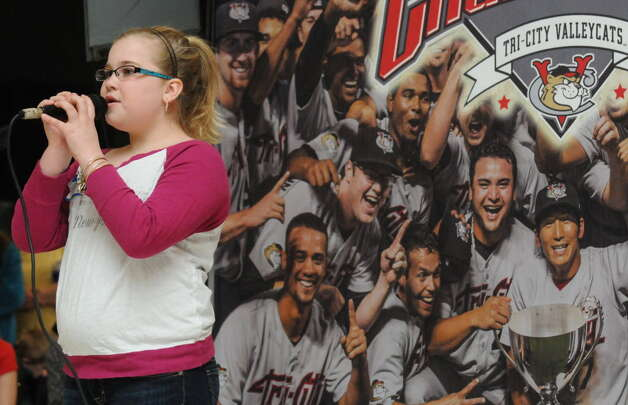 Ten-year-old Jennifer Acker of Melrose sings the, National Anthem, as the Tri-City ValleyCats held tryouts for prospective singers for the upcoming season at Crossgates Mall on Saturday April 5, 2014 in Guilderland N.Y. (Michael P. Farrell/Times Union archive)