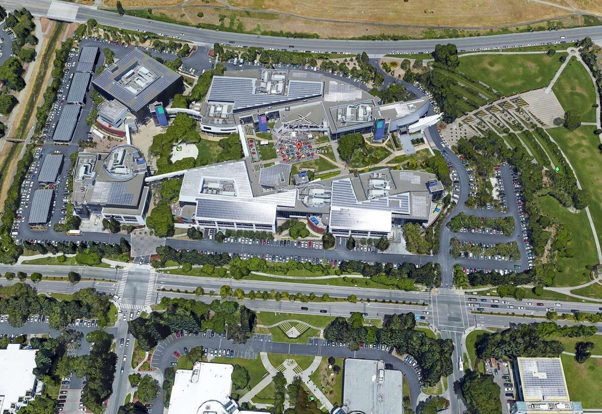 The Google headquarters in Mountain View, as seen in a Google Earth view, has large lawns and trees dotting the areas among sprawling buildings. The company is taking a number of measures to slash its water use.