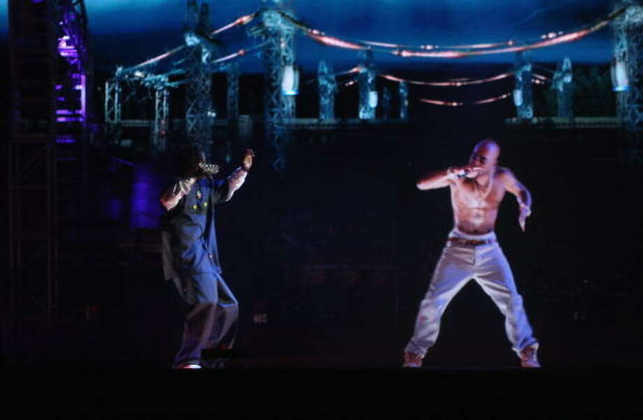 Rapper Snoop Dogg (L) and a hologram of deceased Tupac Shakur perform onstage during day 3 of the 2012 Coachella Valley Music & Arts Festival at the Empire Polo Field on April 15, 2012 in Indio, California.  (Photo by Christopher Polk/Getty Images for Coachella) Photo: Christopher Polk