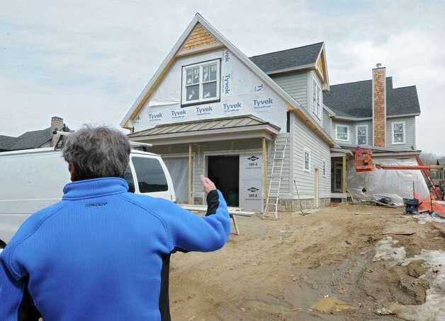 Builder Jeff Snyder, owner of J. Snyder Builders, is seen speaking about the homes he's building in the Oak Ridge subdivision on Monday, April 6, 2015 in Saratoga Springs, N.Y.   (Lori Van Buren / Times Union) Photo: Lori Van Buren / 00031290A