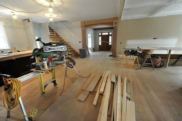 Open space is seen between the kitchen and the living room in a home under construction in the Oak Ridge subdivision on Monday, April 6, 2015 in Saratoga Springs, N.Y. The homes are built by J. Snyder Builders.  (Lori Van Buren / Times Union) Photo: Lori Van Buren / 00031290A