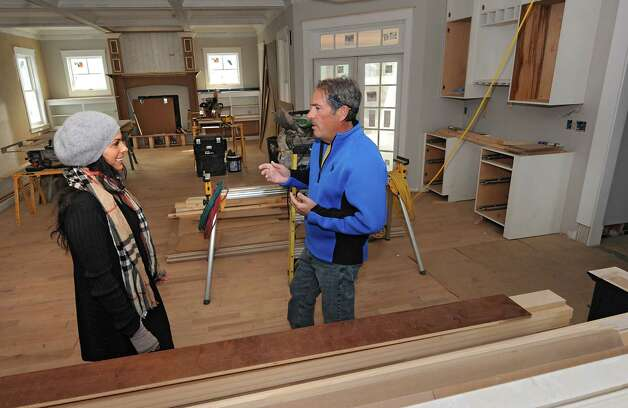 Real estate agent Franca DiCrescenzo, left, and builder Jeff Snyder are seen standing in the open lay out in a home under construction in the Oak Ridge subdivision on Monday, April 6, 2015 in Saratoga Springs, N.Y. The homes are built by Jeff's company J. Snyder Builders.  (Lori Van Buren / Times Union) Photo: Lori Van Buren / 00031290A