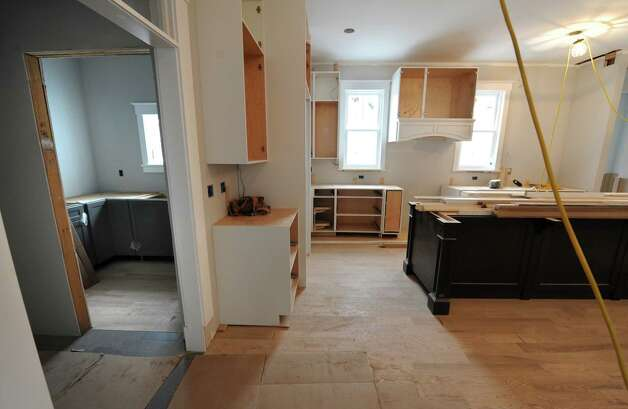 A view of the pantry, on left, and kitchen in a home under construction in the Oak Ridge subdivision on Monday, April 6, 2015 in Saratoga Springs, N.Y. The homes are built by J. Snyder Builders.  (Lori Van Buren / Times Union) Photo: Lori Van Buren / 00031290A