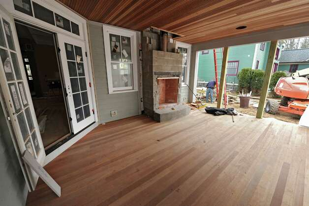 Outdoor room with fireplace on a home under construction in the Oak Ridge subdivision on Monday, April 6, 2015 in Saratoga Springs, N.Y. The homes are built by J. Snyder Builders.  (Lori Van Buren / Times Union) Photo: Lori Van Buren / 00031290A