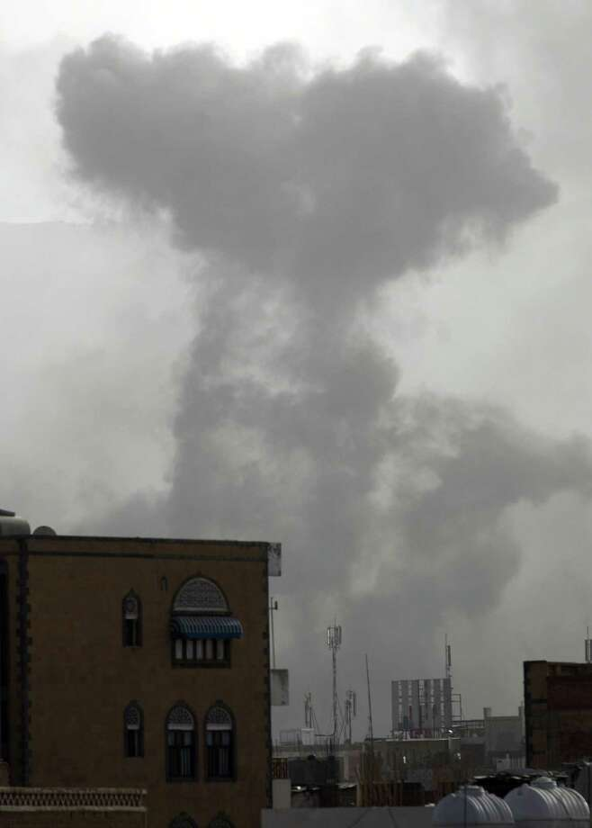 Smoke rises from the Yemeni capital, Sanaa, following an alleged air strike by the Saudi-led alliance on Shiite Houthi rebels camps. Photo: MOHAMMED HUWAIS / AFP / Getty Images / AFP