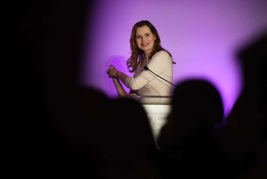 "Academy Award-winning actor Geena Davis pretends to swing a baseball bat while talking about her role in the movie ""A League of Their Own"" during the Fairfield County Community Foundation's Fund for Women and Girls annual luncheon at the Hyatt Regency in Old Greenwich, Conn. Thursday, April 9, 2015.  Davis, along with young speakers Corinne Wilkow, 15, and Eloisa Melendez, 21, told inspirational and empowering stories about overcoming obstacles to become successful women. Photo: Tyler Sizemore / Greenwich Time"