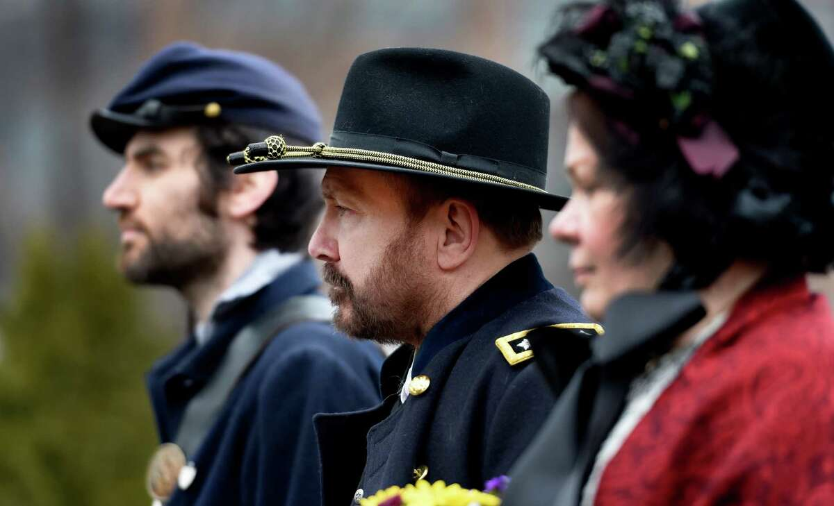 Ben Kemp, left, Steve Trimm, center, and Melissa Trombley of the Grant Cottage staff dressed in period garb during a remembrance ceremony to commemorate the 150th anniversary of the surrender of Gen. Robert E. Lee to Gen U.S. Grant to end the Civil War Thursday afternoon, April 9, 2015, at Congress Park in Saratoga Springs, N.Y. (Skip Dickstein/Times Union)