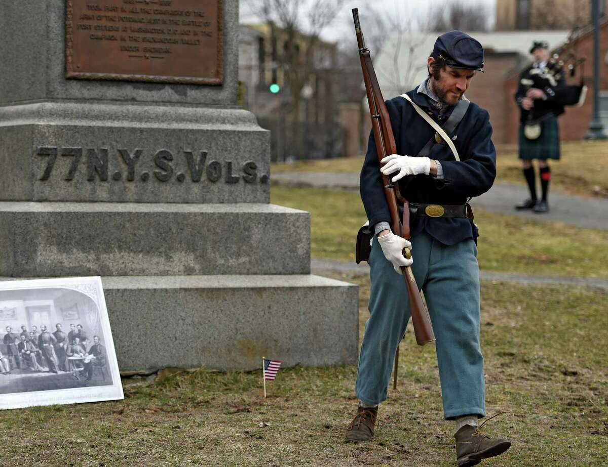 Ben Kemp of the Grant Cottage staff, dressed in Union Army garb, walks from the 77th N.Y. Volunteer's memorial at Congress Park Thursday afternoon April 9, 2015, in Saratoga Springs, N.Y., during a remembrance ceremony to commemorate to the 150th anniversary ceremony of the surrender of Gen. Robert E. Lee's surrender to Gen U.S. Grant to end the Civil War. (Skip Dickstein/Times Union)