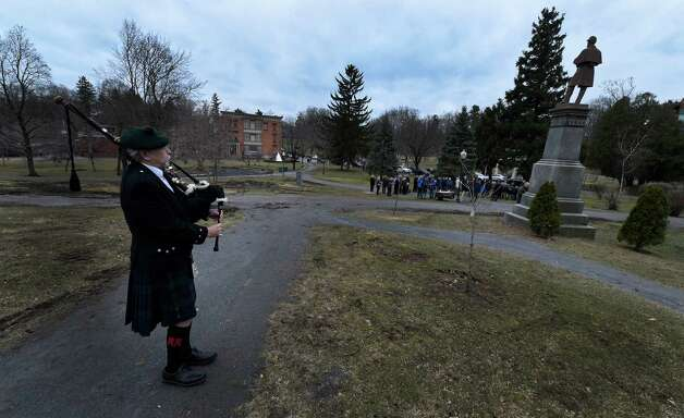 A lone piper, Jerry Cashin, plays in Congress Park Thursday afternoon, April 9, 2015 in Saratoga Springs, N.Y., during a ceremony to commemorate the 150th anniversary of the surrender of Gen. Robert E. Lee to Gen U.S. Grant to end the Civil War. (Skip Dickstein/Times Union) Photo: SKIP DICKSTEIN / 00031357A