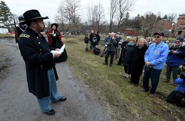Steve Trimm of the Grant Cottage staff, dressed as Gen. U. S. Grant, gives a speech about the moments preceding the surrender of Gen. Lee to Gen. Grant to end the Civil War during a ceremony to commemorate to the 150th anniversary of the historic moment Thursday afternoon, April 9, 2015, at Congress Park in Saratoga Springs, N.Y. (Skip Dickstein/Times Union) Photo: SKIP DICKSTEIN / 00031357A