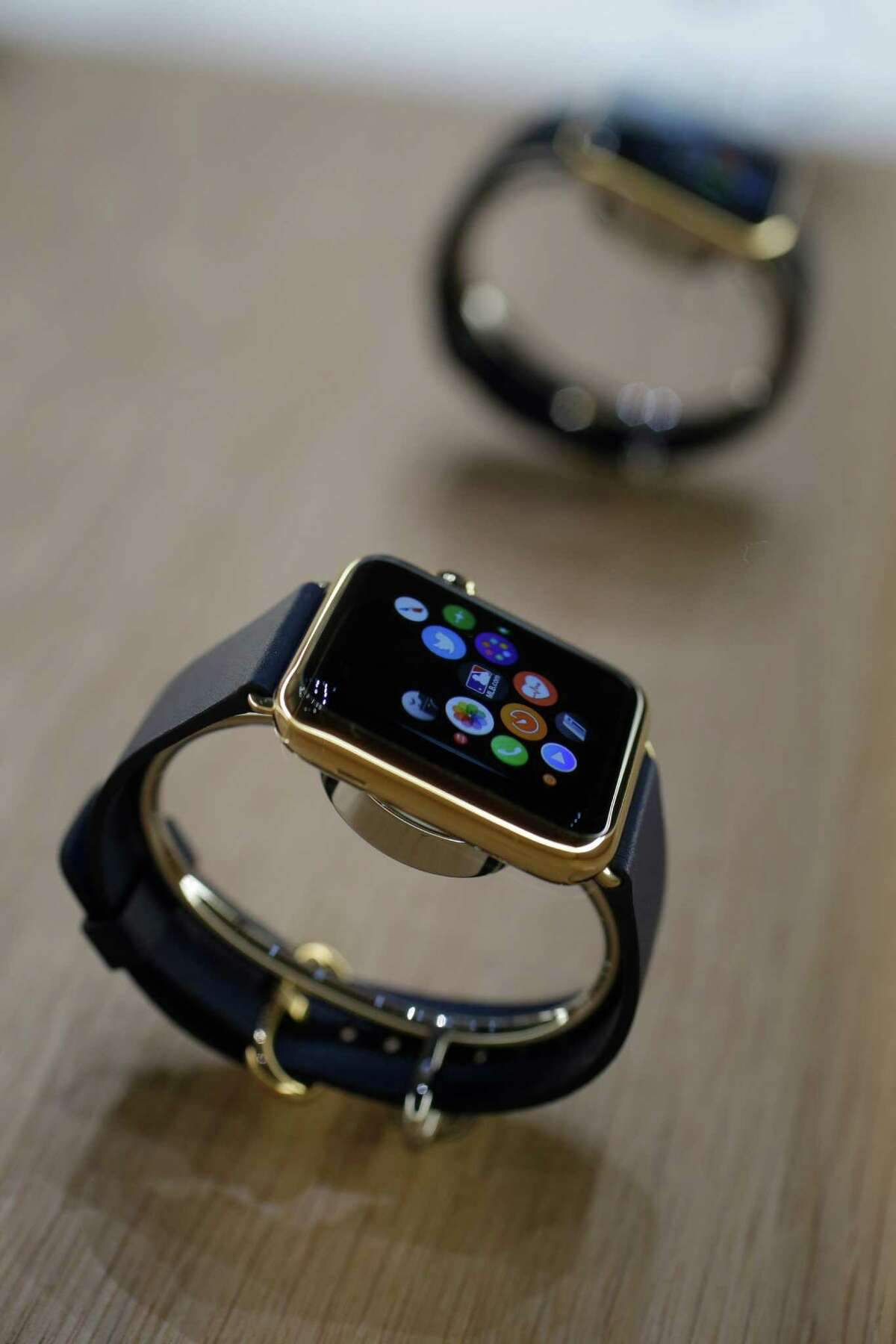 FILE - In this Sept. 9 2014 file photo, varieties of the new Apple Watch are displayed during an event in Cupertino, Calif. Apple Watch, available for pre-order on Friday, April 10, 2015, comes with a choice of watch case, band and size _ there are 54 possible configurations in all. (AP Photo/Marcio Jose Sanchez, File)