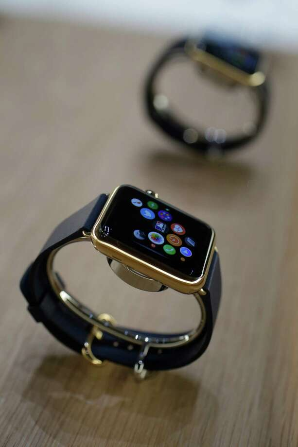 FILE - In this Sept. 9 2014 file photo, varieties of the new Apple Watch are displayed during an event in Cupertino, Calif. Apple Watch, available for pre-order on Friday, April 10, 2015, comes with a choice of watch case, band and size _ there are 54 possible configurations in all. (AP Photo/Marcio Jose Sanchez, File) Photo: Marcio Jose Sanchez / Associated Press / AP