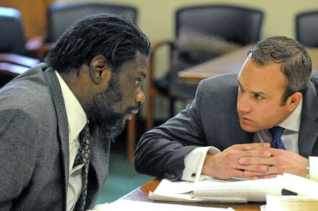 Herman Robinson, left, talks with a member of his defense team, Nathan Writer, as arguments are heard by State Supreme Court Judge Michael Coccoma on Thursday April 9, 2015, at Schenectady County Court in Schenectady, N.Y. (Michael P. Farrell/Times Union) Photo: Michael P. Farrell / 00031367A