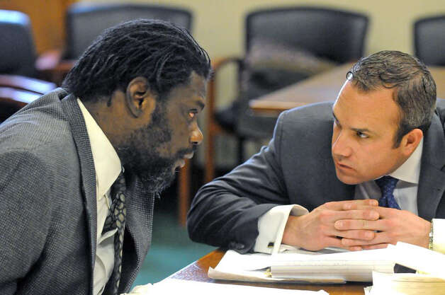 Herman Robinson, left, appears for his trial in Schenectady County Court Thursday. (Michael P. Farrell/Times Union)