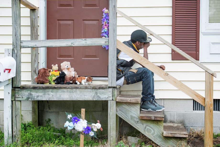 Family friend James Hunter cries on the doorstep of the Todd family house after Rodney Todd and his seven children were found dead in their home in Princess Anne, Md., on April 6. Photo: DAVIDSON, Washington Post / THE WASHINGTON POST