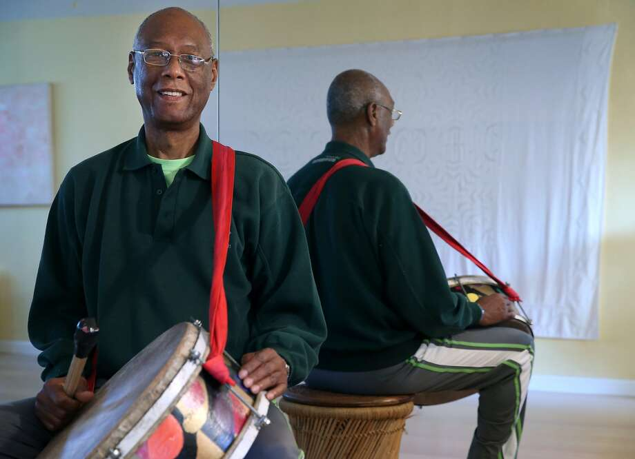 Roberto Borrell, seen at his Berkeley home with a bombo drum, left Cuba in 1980 and has performed and taught dancing in the Bay Area for many years. Photo: Paul Chinn, The Chronicle