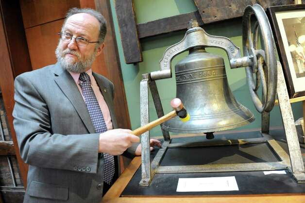 "Executive director Michael Barrett rings a Meneely bell on Thursday, April 9, 2015, at Burden Ironworks Museum in Troy, N.Y. The National Park Service organized a ""Bells Across the Land"" event to commemorate the surrender of Robert E. Lee to Ulysses S. Grant 150 years ago. Organization with a bell were asked to ring it for four minutes, which represents the four years of the Civil War. (Cindy Schultz / Times Union) Photo: Cindy Schultz / 00031362A"