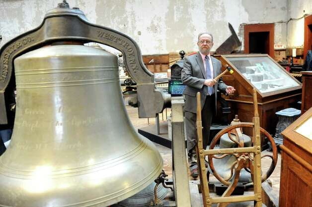 "Executive director Michael Barrett stands among Meneely bells on Thursday, April 9, 2015, at Burden Ironworks Museum in Troy, N.Y. The National Park Service organized a ""Bells Across the Land"" event to commemorate the surrender of Robert E. Lee to Ulysses S. Grant 150 years ago. Organization with a bell were asked to ring it for four minutes, which represents the four years of the Civil War. (Cindy Schultz / Times Union) Photo: Cindy Schultz / 00031362A"