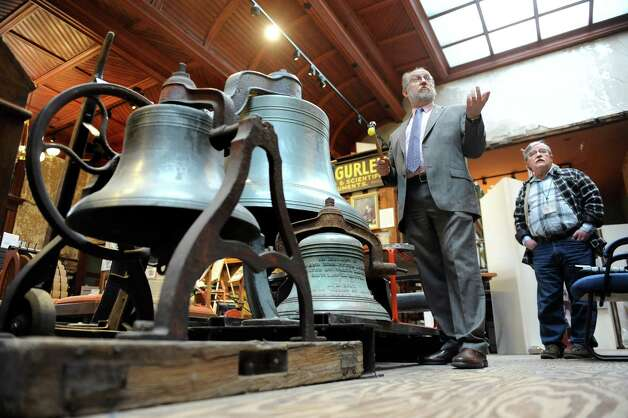 "Executive director Michael Barrett, center, rings Meneely bells on Thursday, April 9, 2015, at Burden Ironworks Museum in Troy, N.Y. Joining him as Andy Mace, who plays chimes at Troy's St. John's Episcopal Church. The chimes comprised 11 Meneely bells. The National Park Service organized a ""Bells Across the Land"" event to commemorate the surrender of Robert E. Lee to Ulysses S. Grant 150 years ago. Organization with a bell were asked to ring it for four minutes, which represents the four years of the Civil War. (Cindy Schultz / Times Union) Photo: Cindy Schultz / 00031362A"