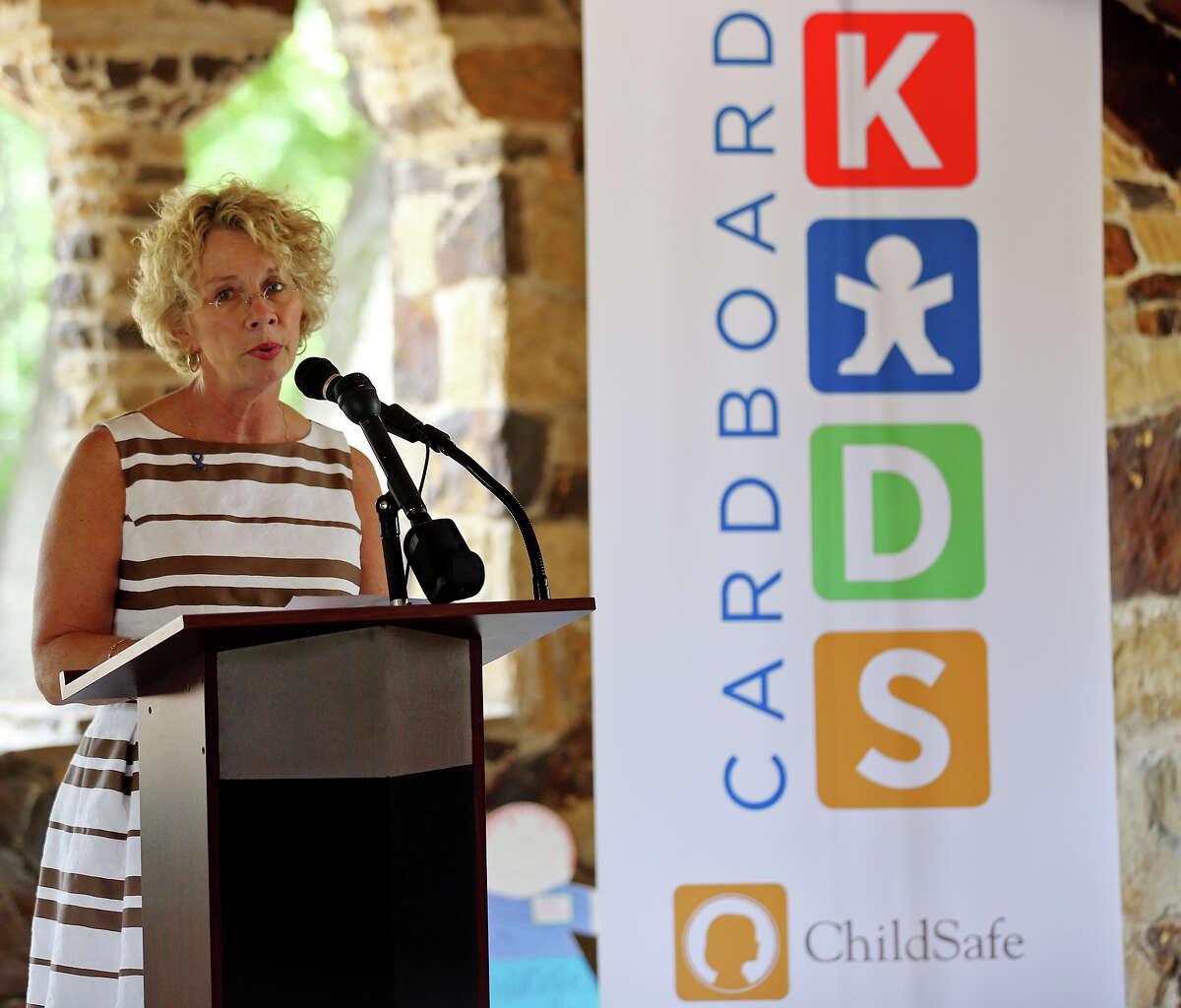 ChildSafe President and CEO Kim Abernethy speaks during a press conference held Thursday April 9, 2015 at the Joske Pavilion in Brackenridge Park, where ChildSafe's Cardboard Kids were displayed. April is National Child Abuse Prevention month.
