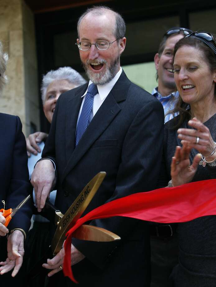 Orinda mayor Steve Glazer has the honor of wielding the big scissors at a ribbon cutting ceremony for an affordable housing complex for seniors in Orinda, Calif. on Thursday, April 9, 2015. Glazer is facing a runoff election in May against Assemblywoman Susan Bonilla for the 7th District Senate seat which opened up when Mark DeSaulnier was elected to the U.S. Congress. Photo: Paul Chinn, The Chronicle