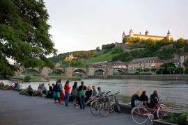 Bring a picnic to the riverbank in Würzburg, Germany, to enjoy a fortress view and convivial people.  RS14Summer_044.jpg