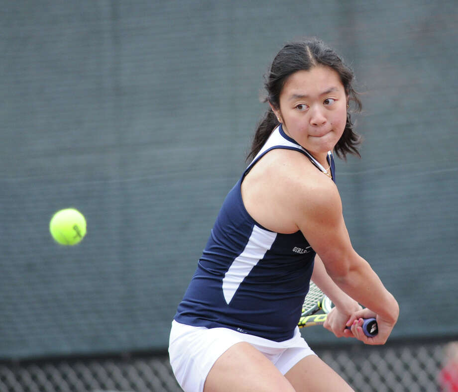Vanessa Mauricio of Staples hits during her match against Maddie Arnold of Greenwich in the girls high school tennis match between Greenwich High School and Staples High School at Greenwich, Conn., Thursday, April 9, 2015. Photo: Bob Luckey / Greenwich Time