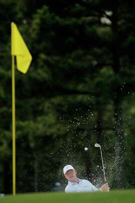 Ernie Els of South Africa plays a bunker shot on the 17th hole during the first round of the 2015 Masters Tournament at Augusta National Golf Club on April 9, 2015, in Augusta, Ga.