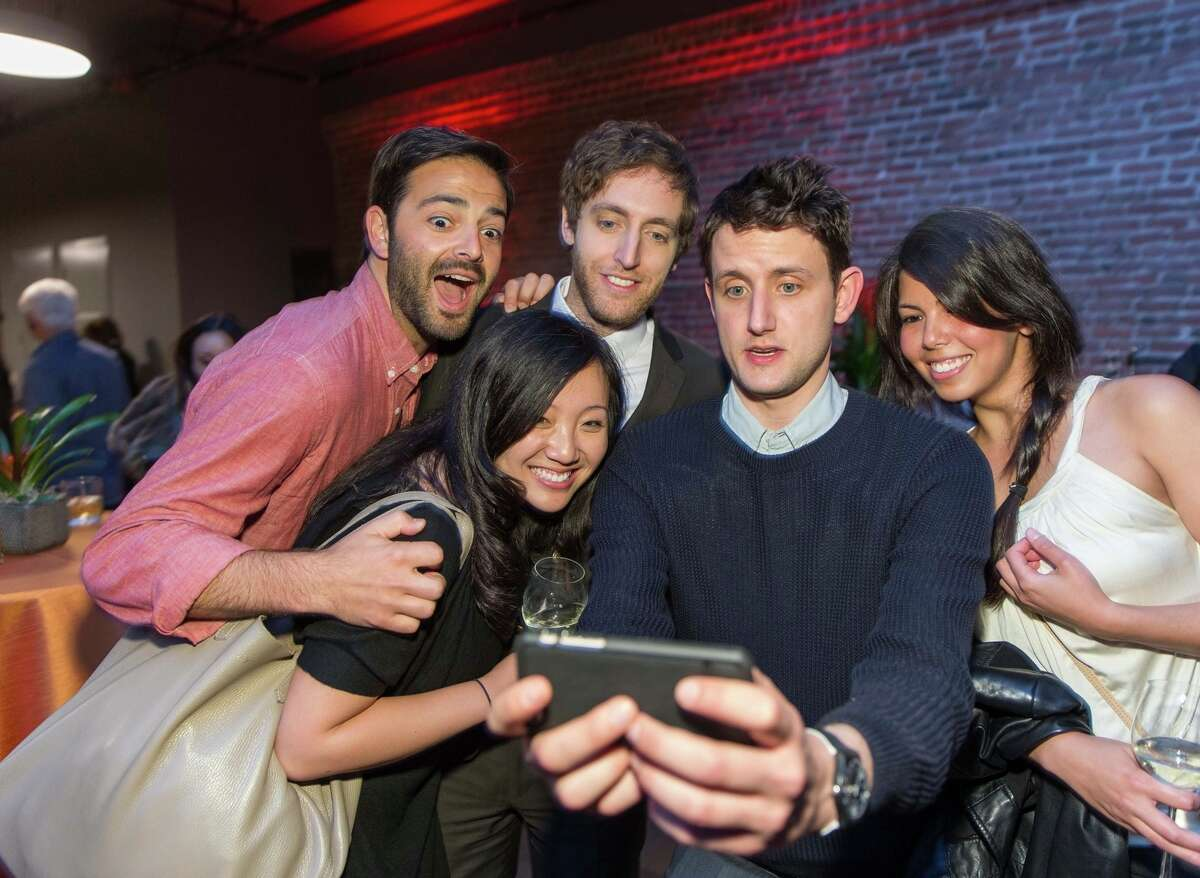 """Noah Lichtenstein (left), Joanne Yuan, actor Thomas Middleditch, actor Zach Woods and Nadia Eghbal snap a shot at Wednesday's screening of season two """"Silicon Valley"""" episodes in San Francisco."""