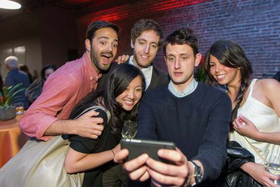 "Noah Lichtenstein (left), Joanne Yuan, actor Thomas Middleditch, actor Zach Woods and Nadia Eghbal snap a shot at Wednesday's screening of season two ""Silicon Valley"" episodes in San Francisco."