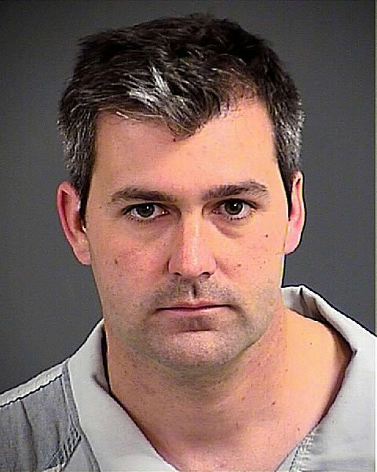 NORTH CHARLESTON, SC - APRIL 7: (EDITOR'S NOTE: Best quality available) In this handout photo provided by the Charleston County Detention Center, police officer Michael Slager poses for his mug shot after being arrested on a charge of murder on April 7, 2015 in North Charleston, South Carolina. Officer Slager shot Walter Scott, who was unarmed, in the back as he was running away after an altercation during a traffic stop on April 4. (Photo by Charleston County Detention Center via Getty Images)