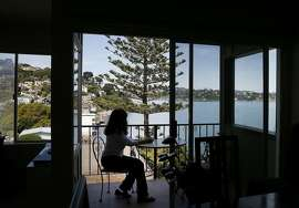 The views and the proximity to downtown Sausalito are big advantages of the small condo Thursday April 9, 2015. Even in a hot real estate market, where homes can sell in days or weeks, some homes linger on the market. A condo in Sausalito, Calif. on South Street has been on the market for about a year.