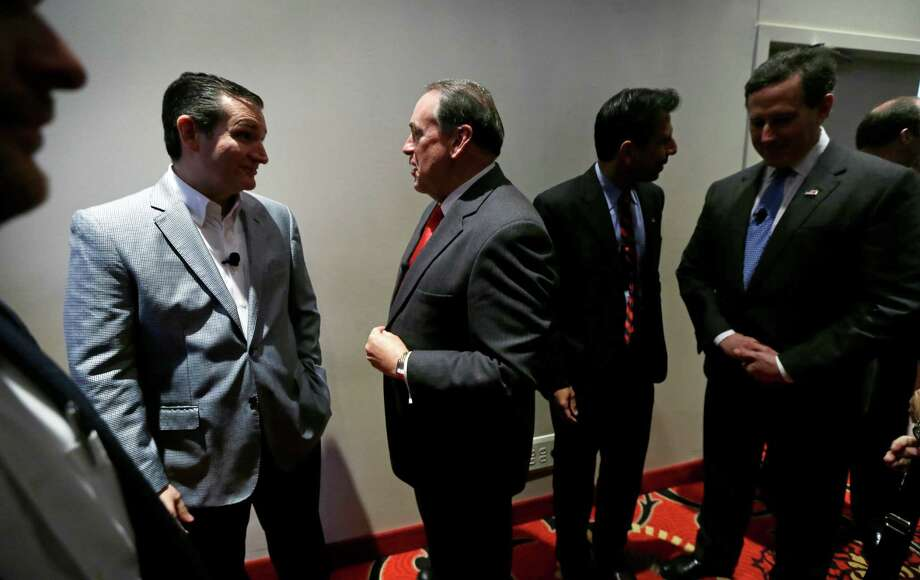 From left, Republican Presidential candidate, Sen. Ted Cruz, R-Texas, former Arkansas Gov. Mike Huckabee, Louisiana Gov. Bobby Jindal and former Pennsylvania Sen. Rick Santorum talk backstage before speaking during the Homeschool Iowa's Capitol Day, Thursday, April 9, 2015, in Des Moines, Iowa. (AP Photo/Charlie Neibergall) Photo: Charlie Neibergall, STF / Associated Press / AP