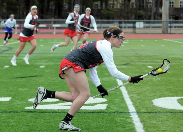 Niskayuna's Cara La Porta brings the ball up field during their girls' high school lacrosse game against Shaker at Shenendehowa High School on Thursday April 9, 2015 in Clifton Park , N.Y. (Michael P. Farrell/Times Union) Photo: Michael P. Farrell / 00031366A