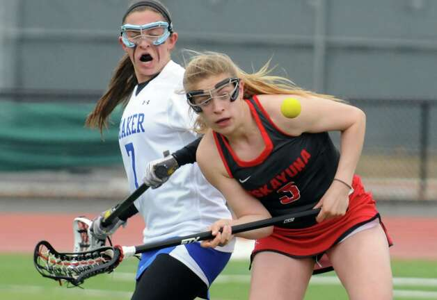 Shaker's A. Conti and Niskayuna's Ellie Petraccione battle for a loose ball during their girls' high school lacrosse game at Shenendehowa High School on Thursday April 9, 2015 in Clifton Park , N.Y. (Michael P. Farrell/Times Union) Photo: Michael P. Farrell / 00031366A